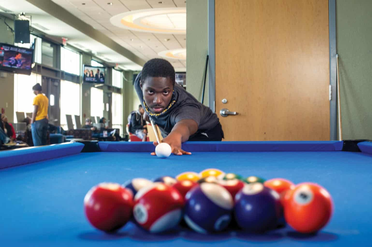 student playing 8-pool