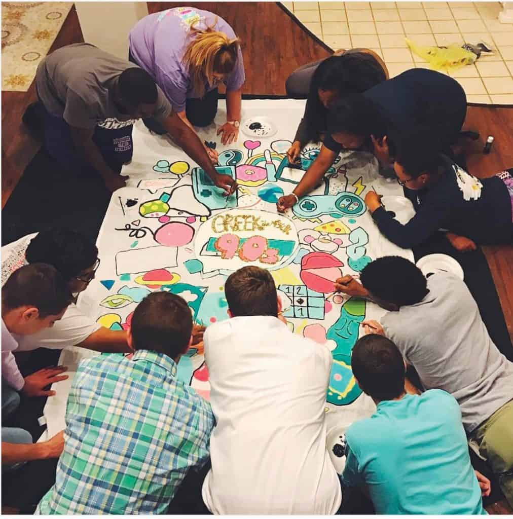 Students coloring together.