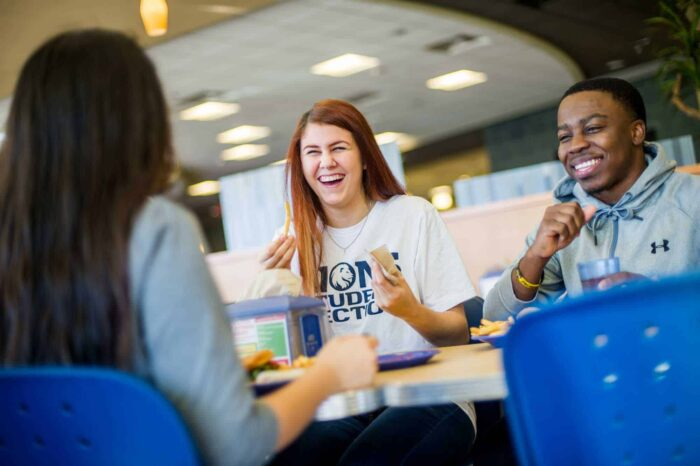Students chuckle laugh at cafeteria