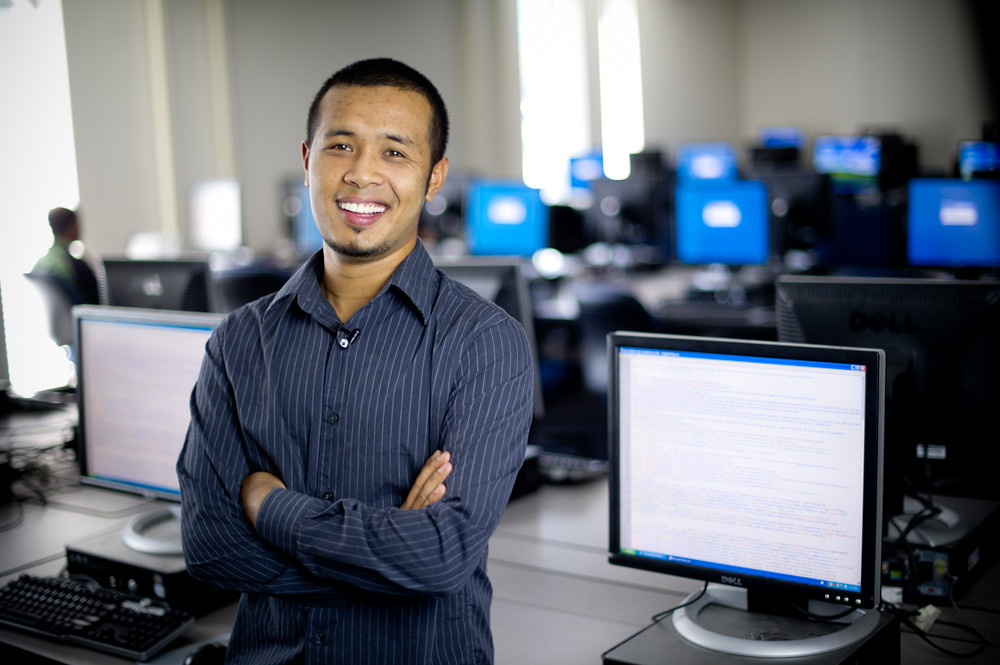 Man standing in front of computers.