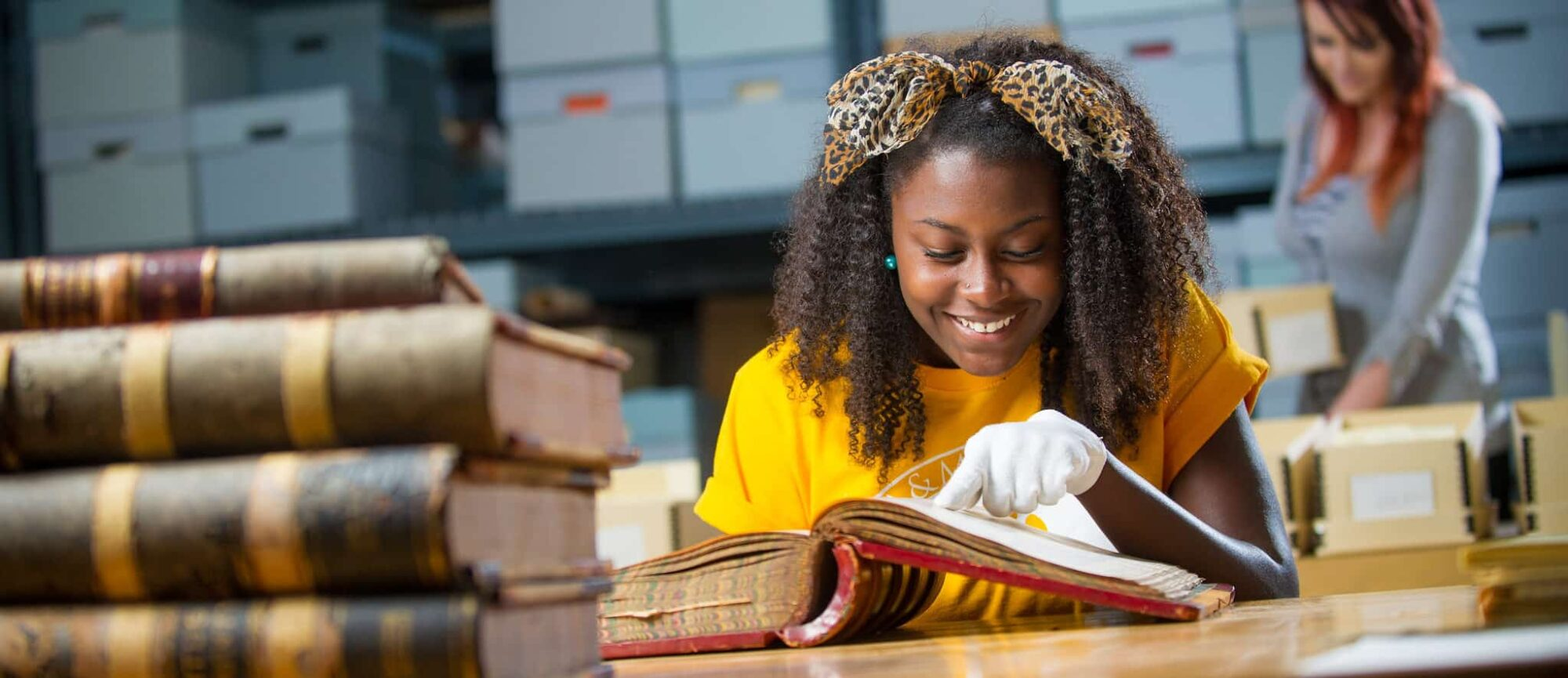Student examining historic book.