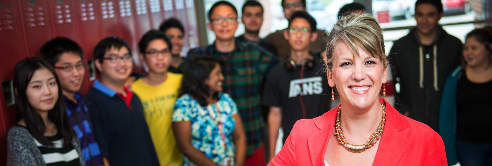 Teacher standing in front of high school students