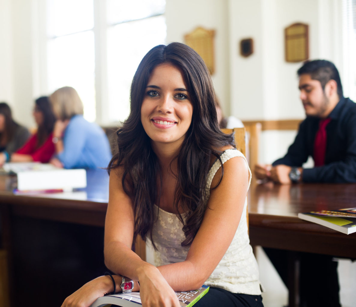 Woman sitting in a spanish classroom.