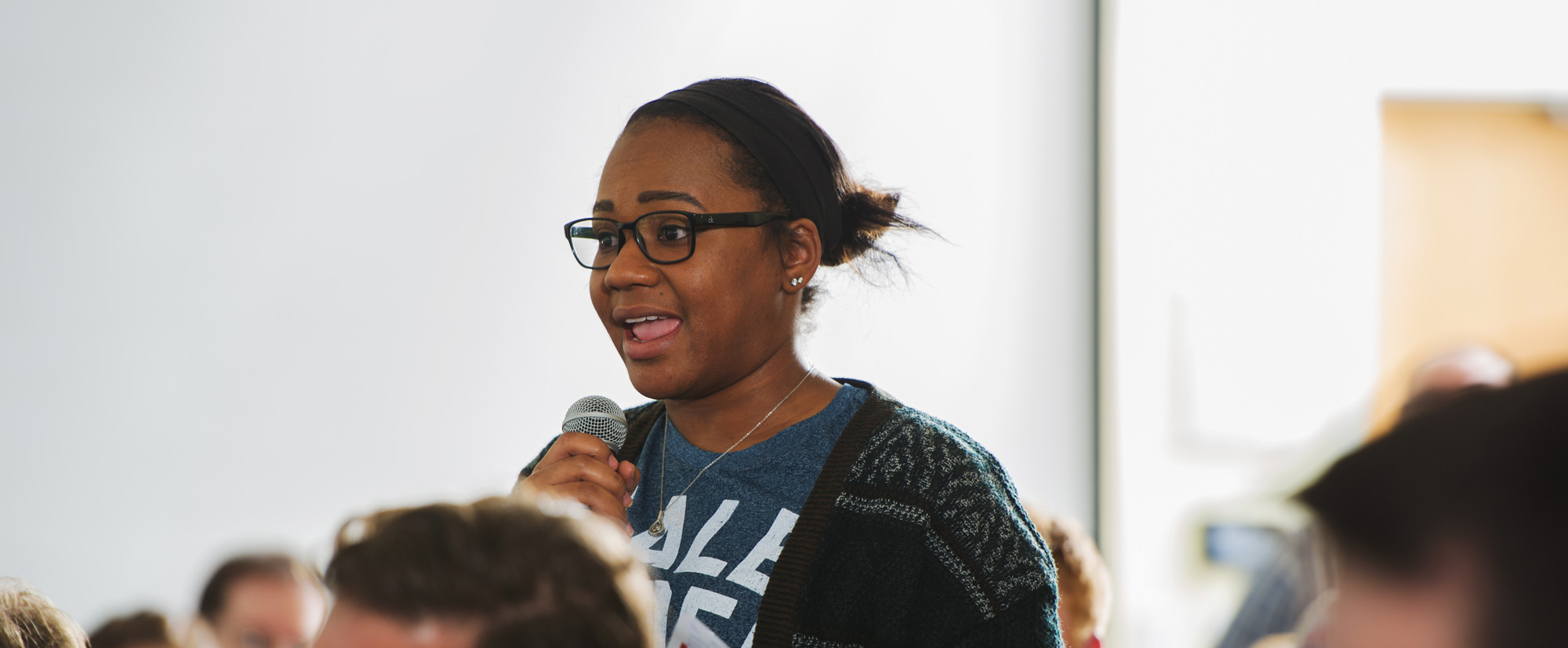 Girl speaking at a political debate.