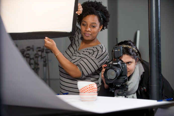 two young females working together on a shoot.