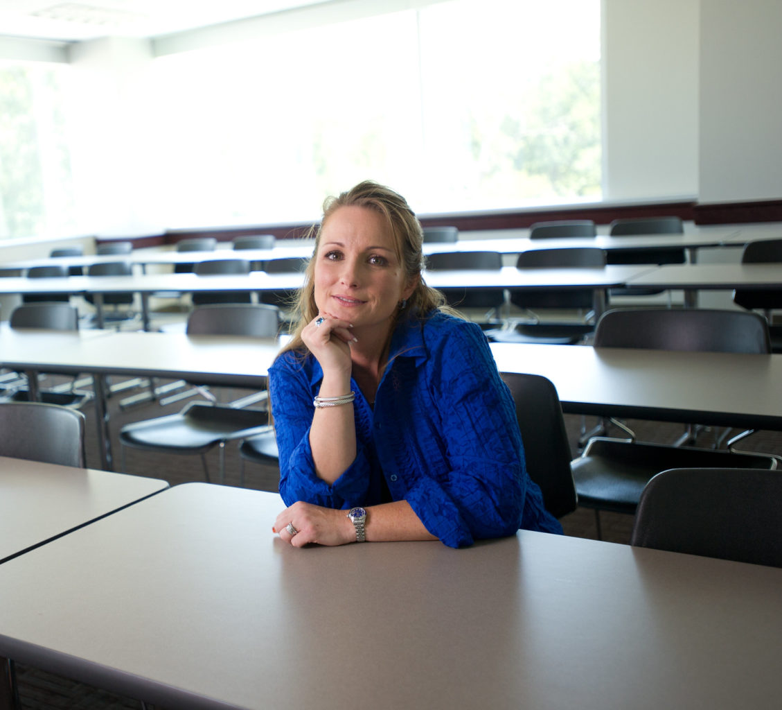 Higher education student sitting in a classroom.