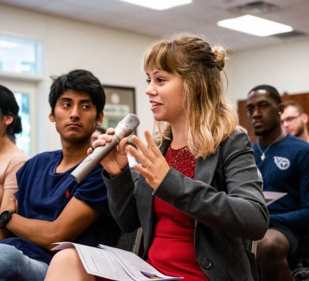 Student speaking holding a speaker