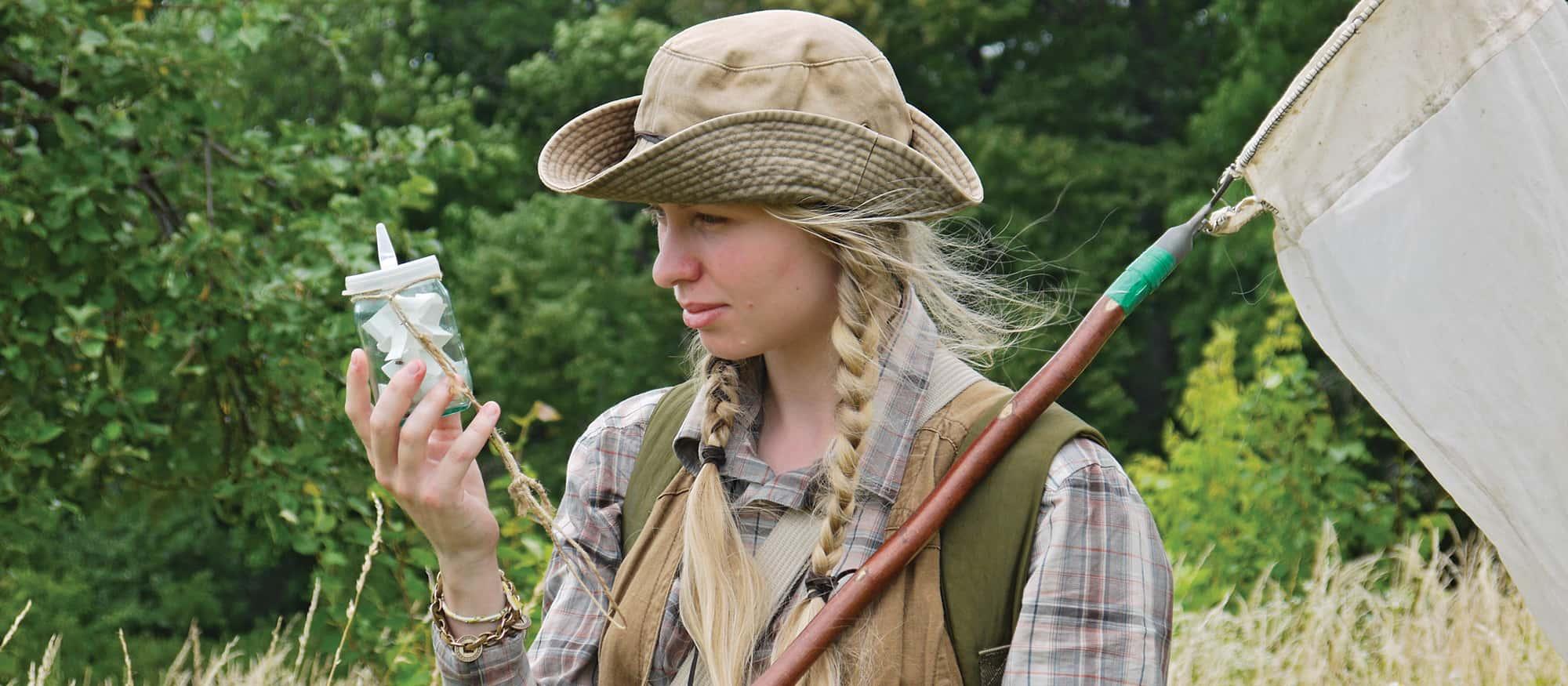 Wildlife Biologist student examining a specimen