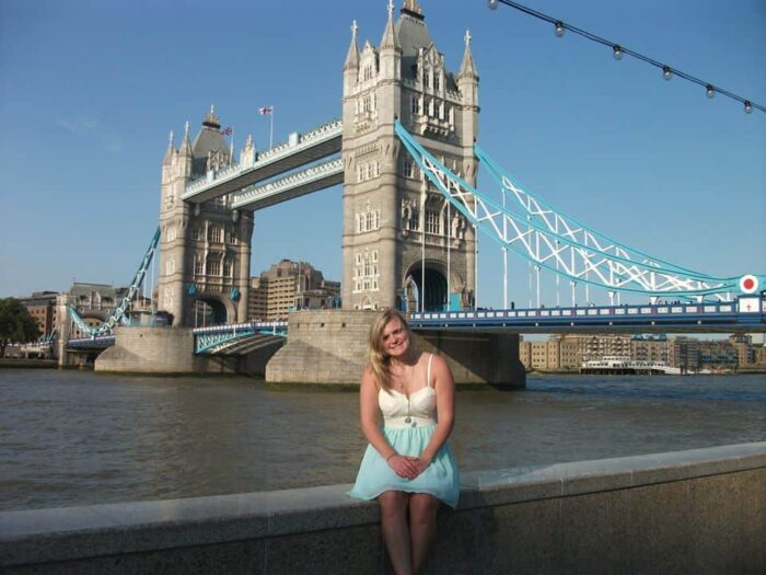 student behind tower bridge
