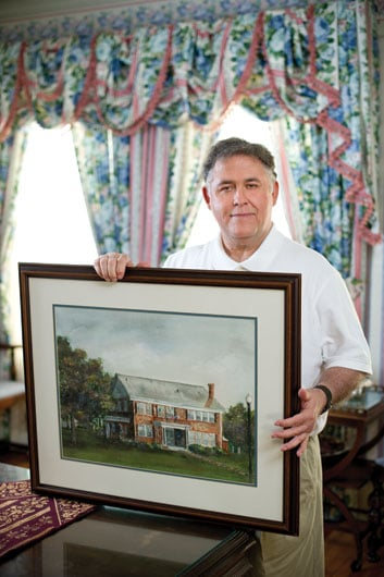 Ted Crim holding Heritage house frame