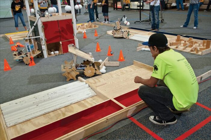 student at robotics competition
