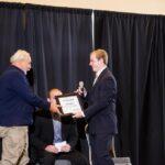 ETWMP: Intern Jackson Dailey presents Karl Clauss with certificate of appreciation