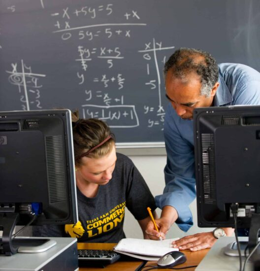 Math professor helping student