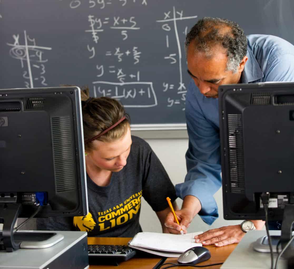 Math professor helping student