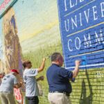 Group gathers to finish the Dr Pepper mural.