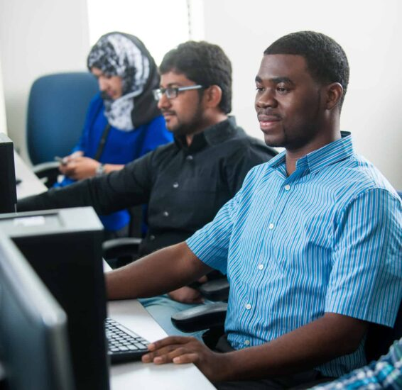 Computer science students working at computers