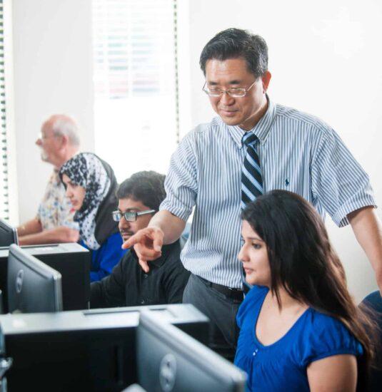 Computer science professor intstructing students