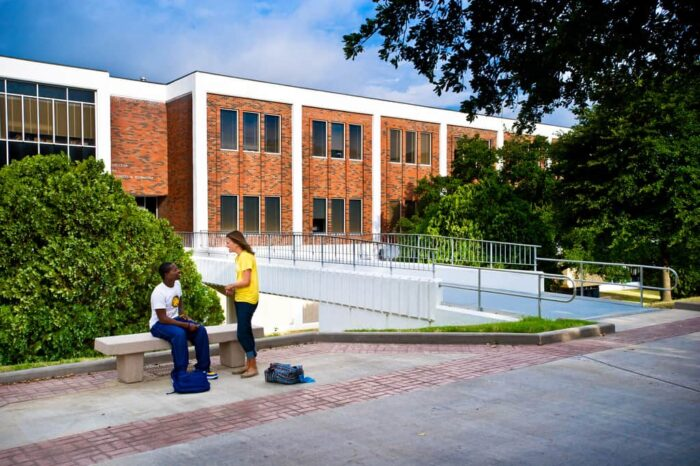 students interacting background 'McDowell Administration Building'