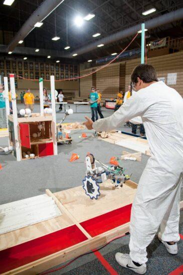 person operating robot at robotics game day