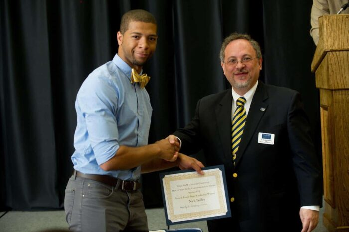 Nick Bailey receiving scholarship winner