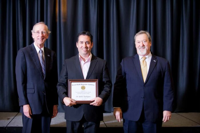 Robert G. Rodriguez receiving Award