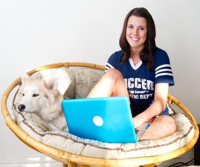 Student with her pet dog and laptop
