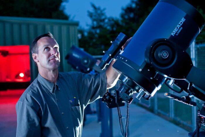 Person holding telescope