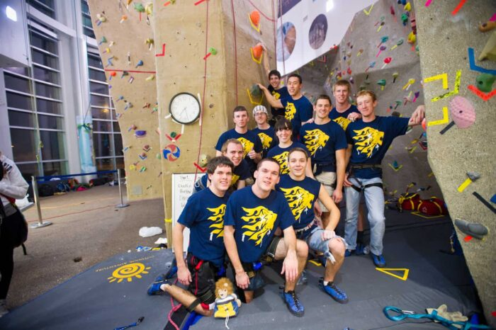 twelve students background 'climbing wall'