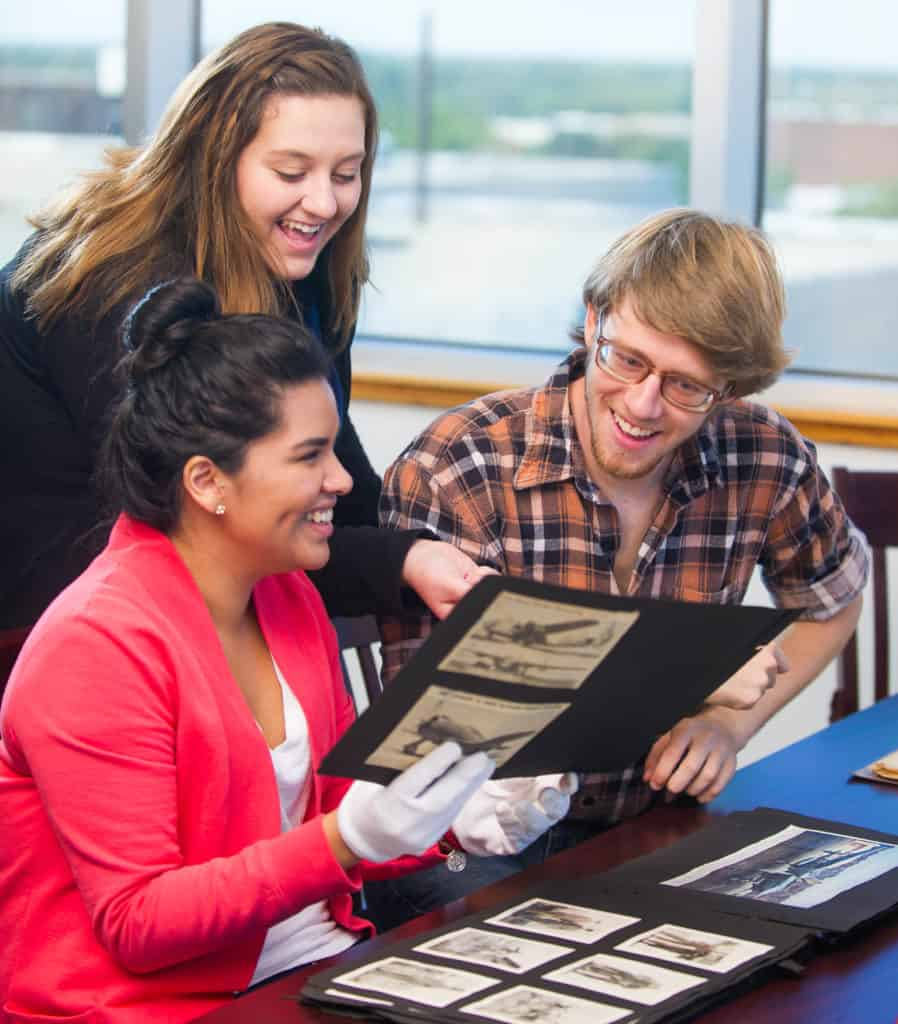 Students looking at historic photographs.