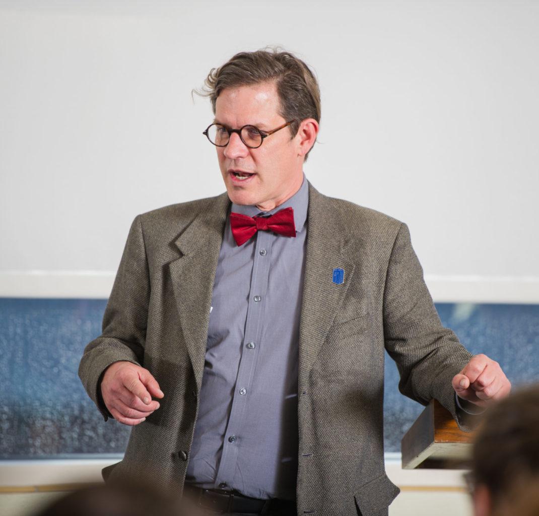 Political science professor at a political debate.