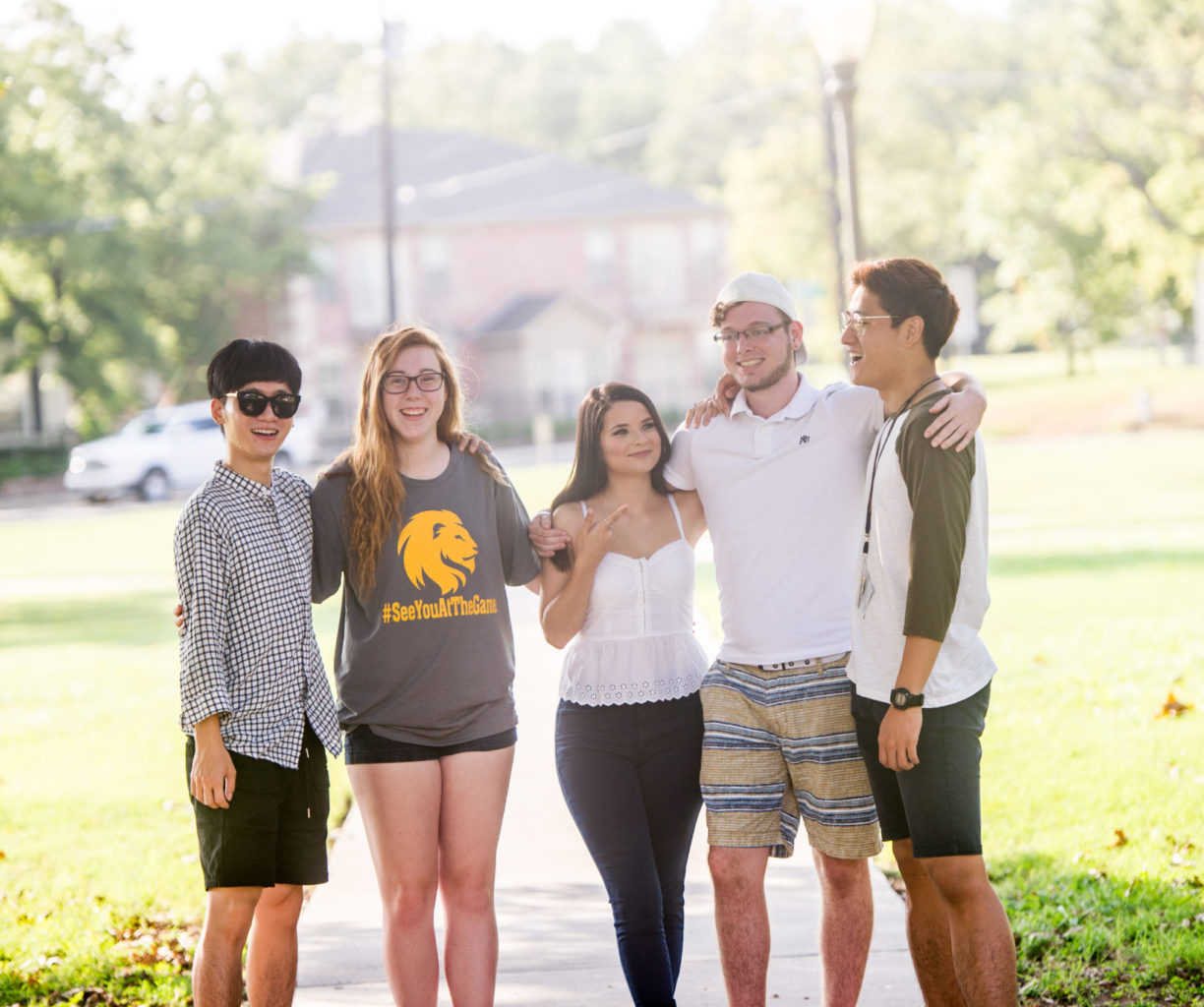 English students standing together on campus.