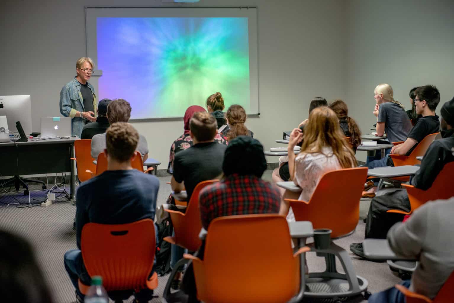 students in classroom listening to professor.