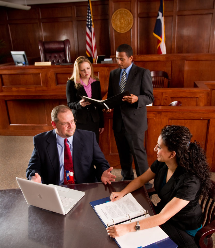 Social workers meeting in a court room.