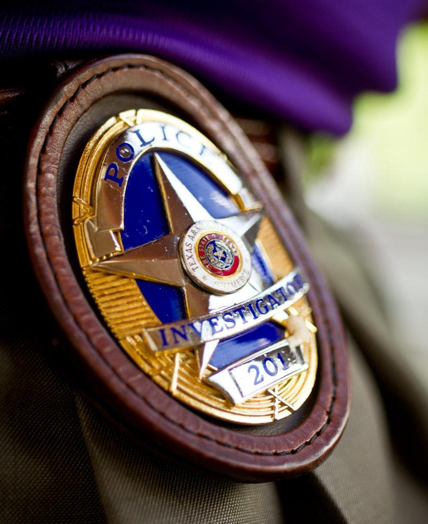 Police officer badge on a belt.