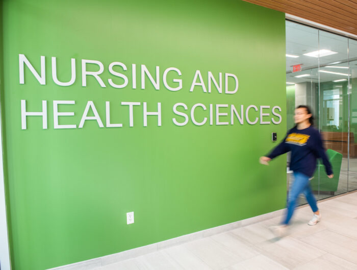 Nursing and Health Sciences sign inside the new health sciences building.