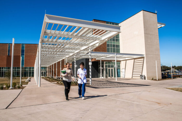 Students departing nursing and health sciences building.
