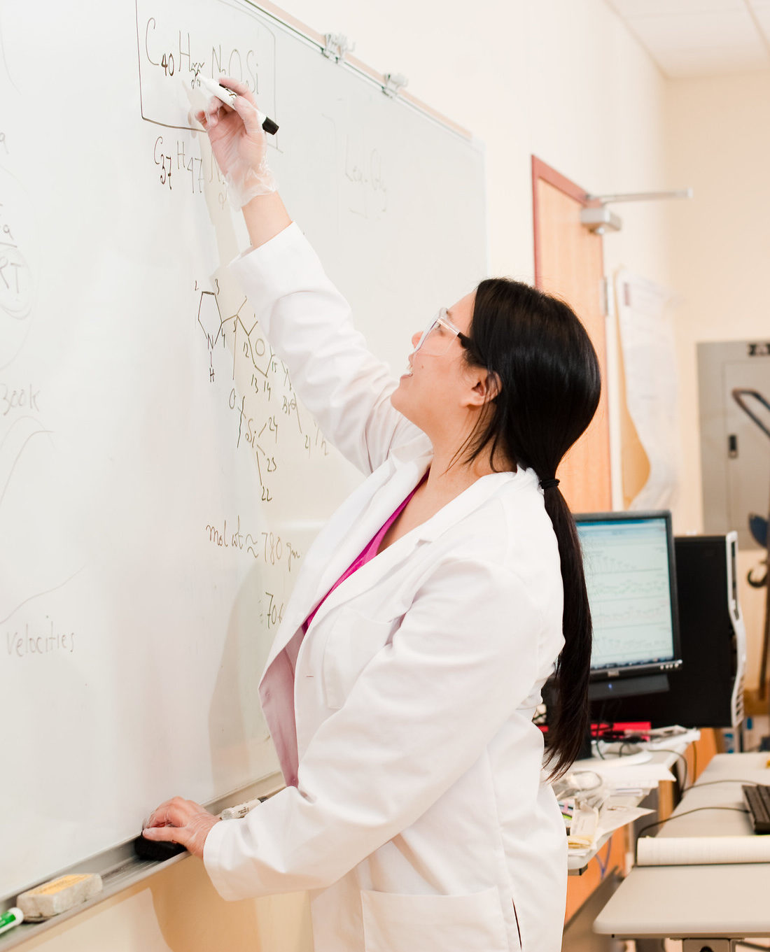 Nursing students solving a problem on a white board.