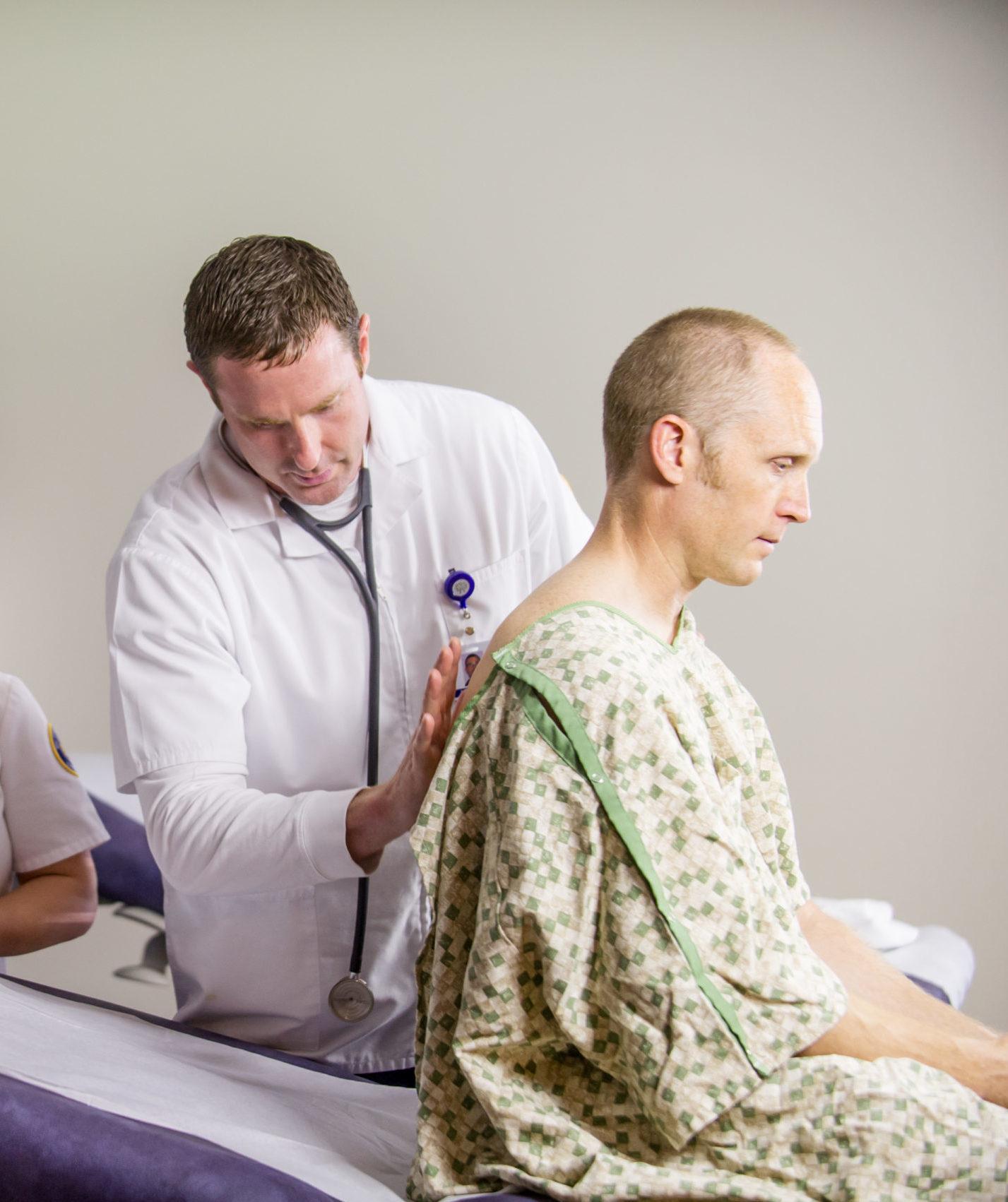 Male nurse examining patient.
