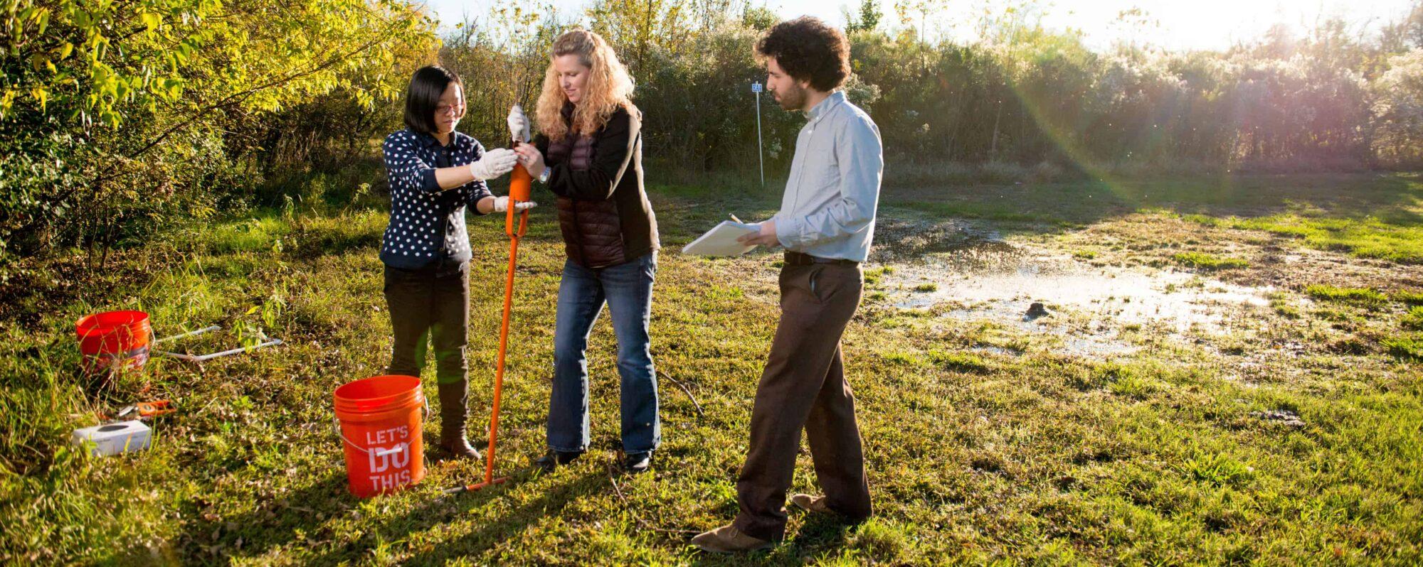 Environmental science studens working in field