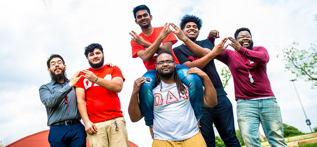 Group of students on a fraternity smiling at the camera.