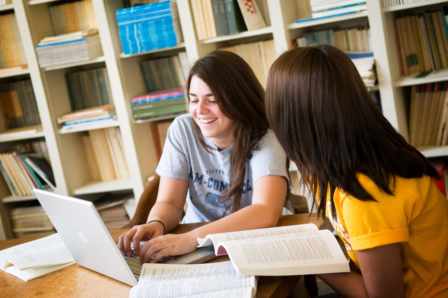 Two students doing homework in the library.