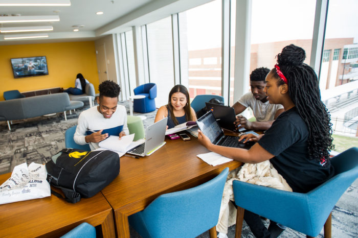A group of students studying together sitting at a table.
