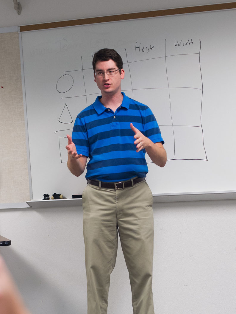 Man teaching a high school classroom.