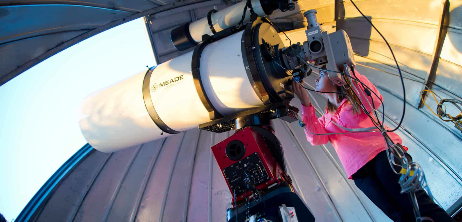 Students positing giant telescope.