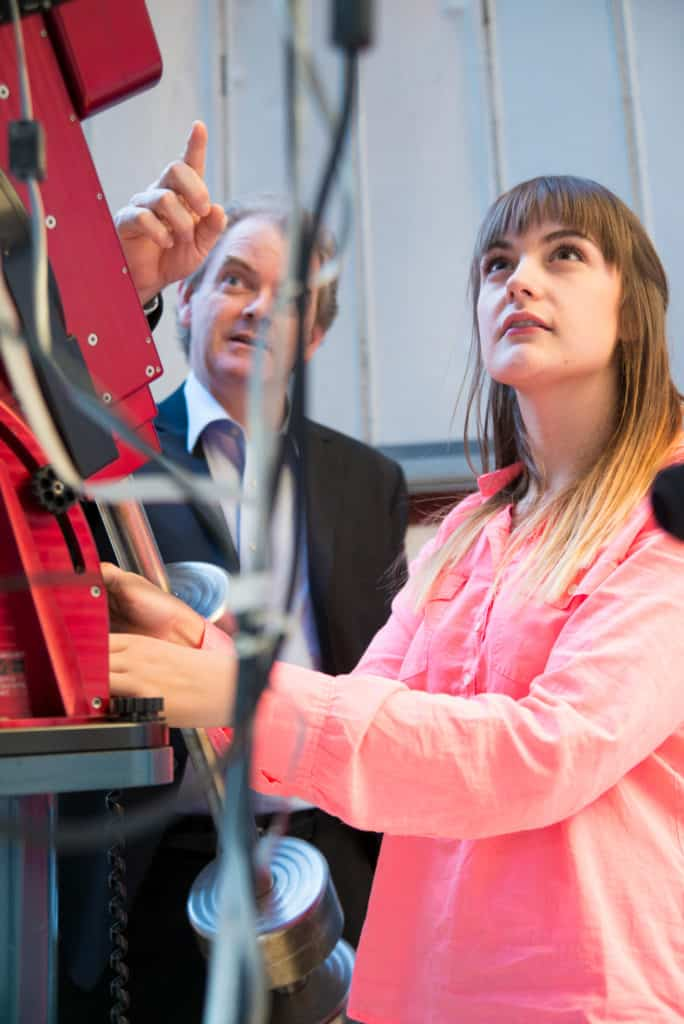 Students looking at hardware.