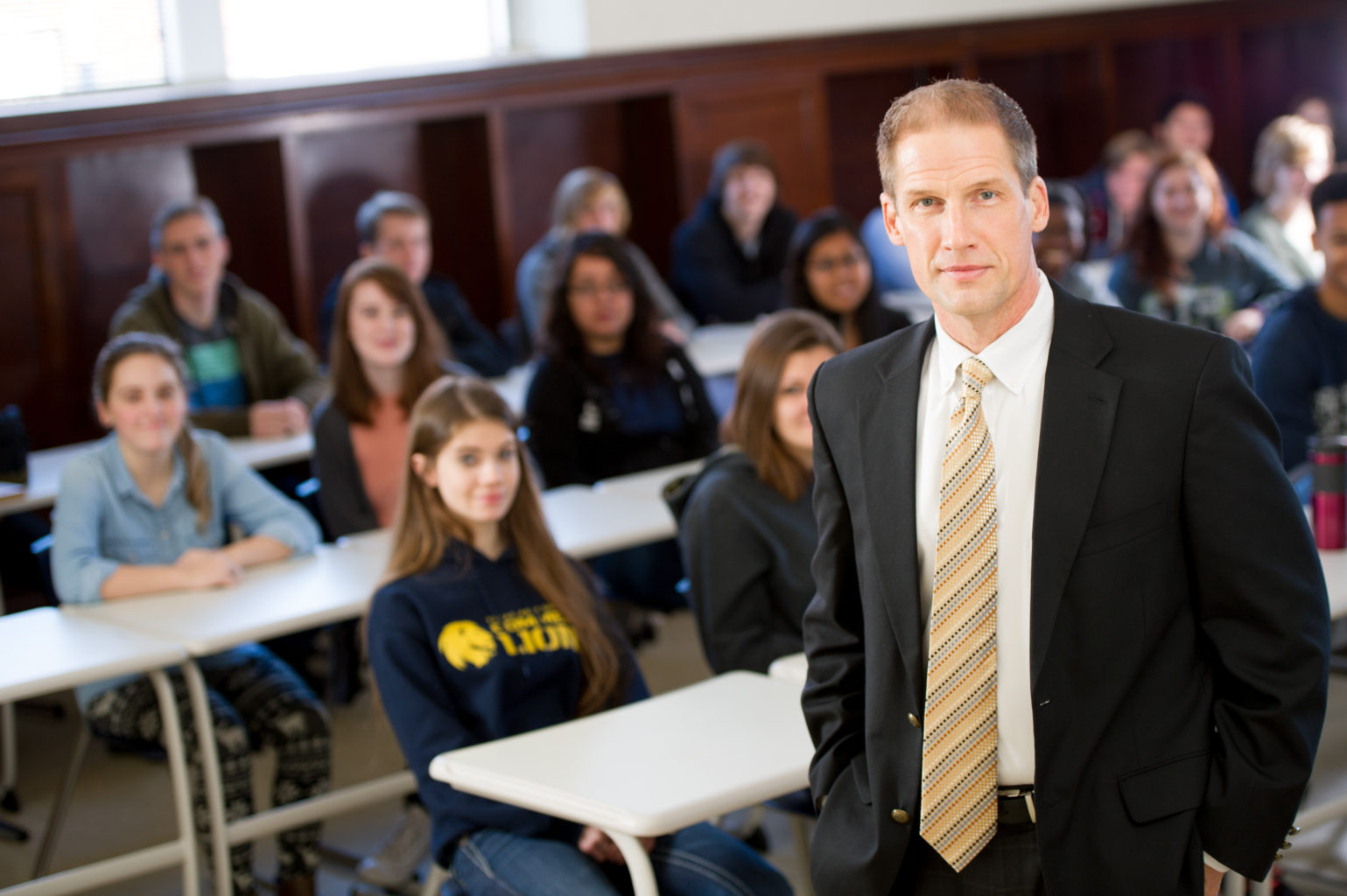 Ricky Dobbs history professor standing in front of class.
