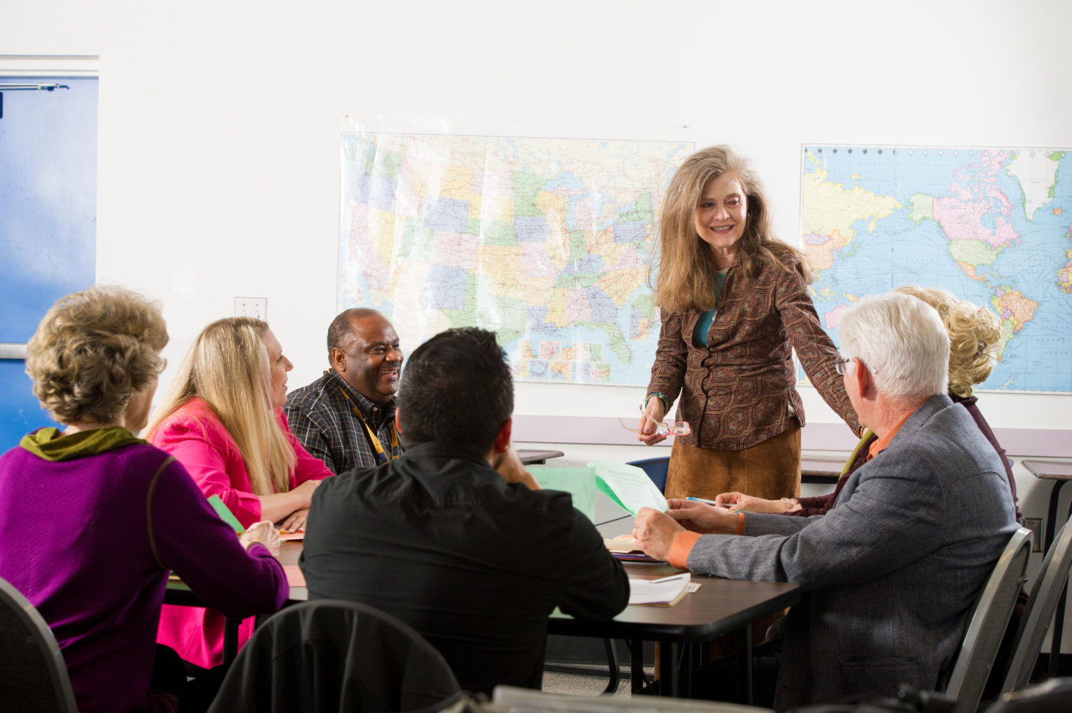 Teacher speaking to fellow faculty members