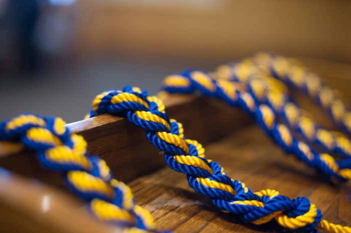 Blue and gold rope strung over a podium.