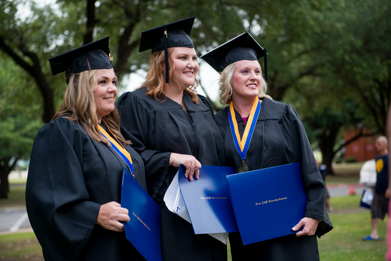 three female graduates talking a pitcure with their diplomas.