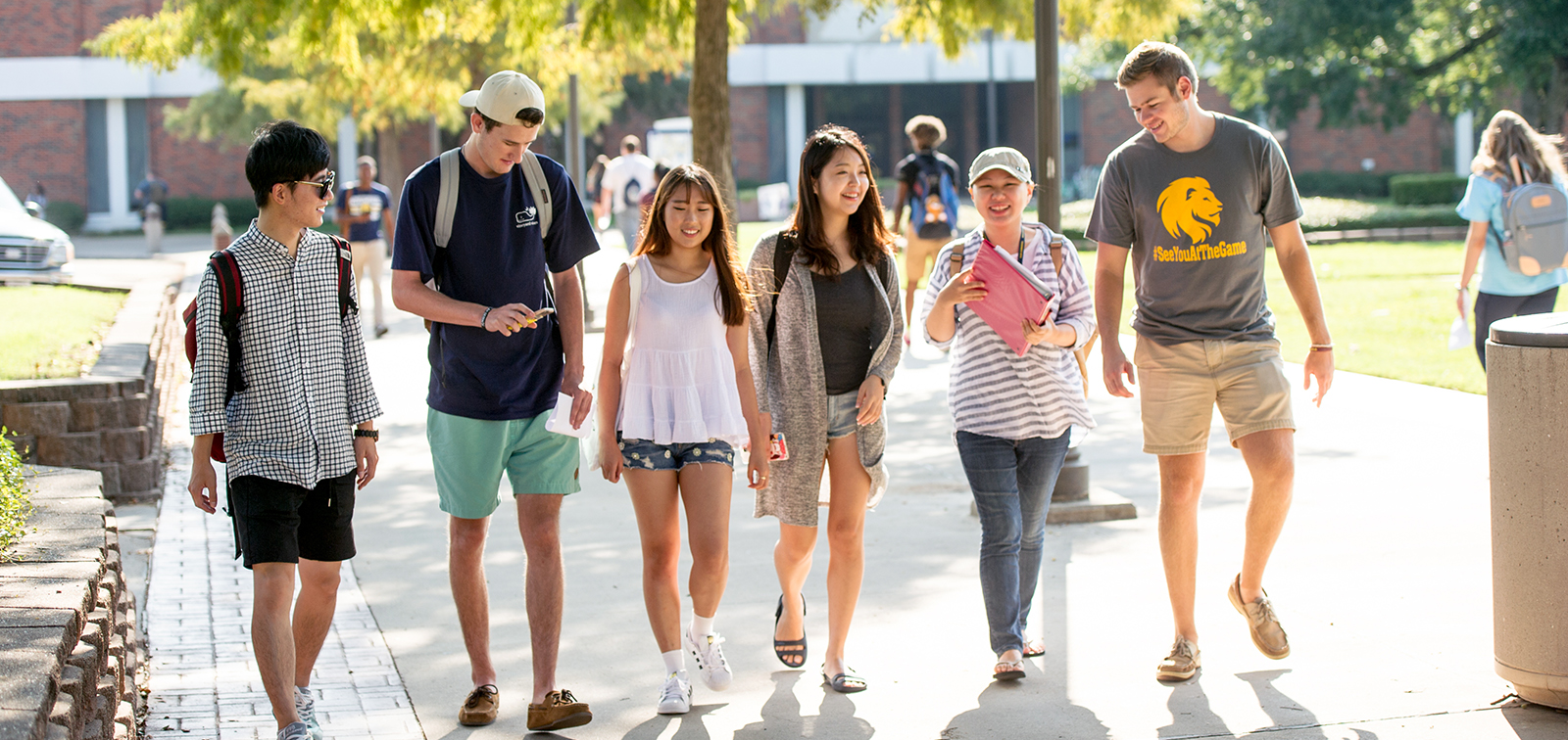 A group of diverse students walking on campus.